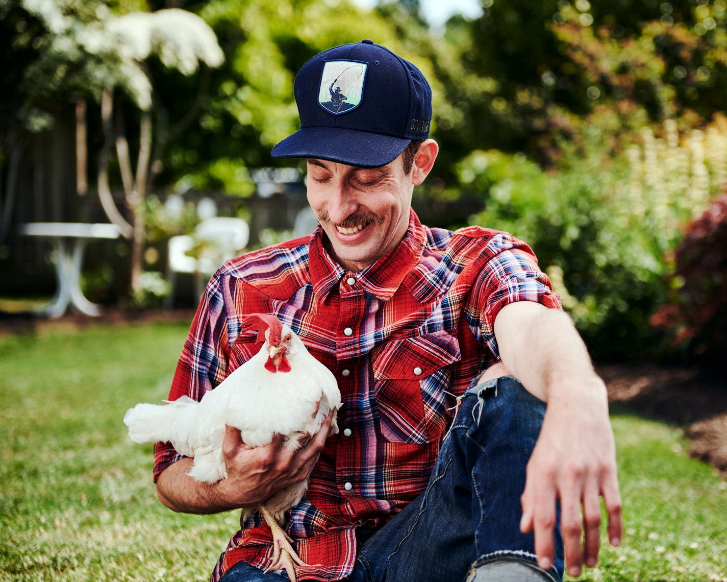 lifestyle photographer Amos Morgan captures a man with his chicken