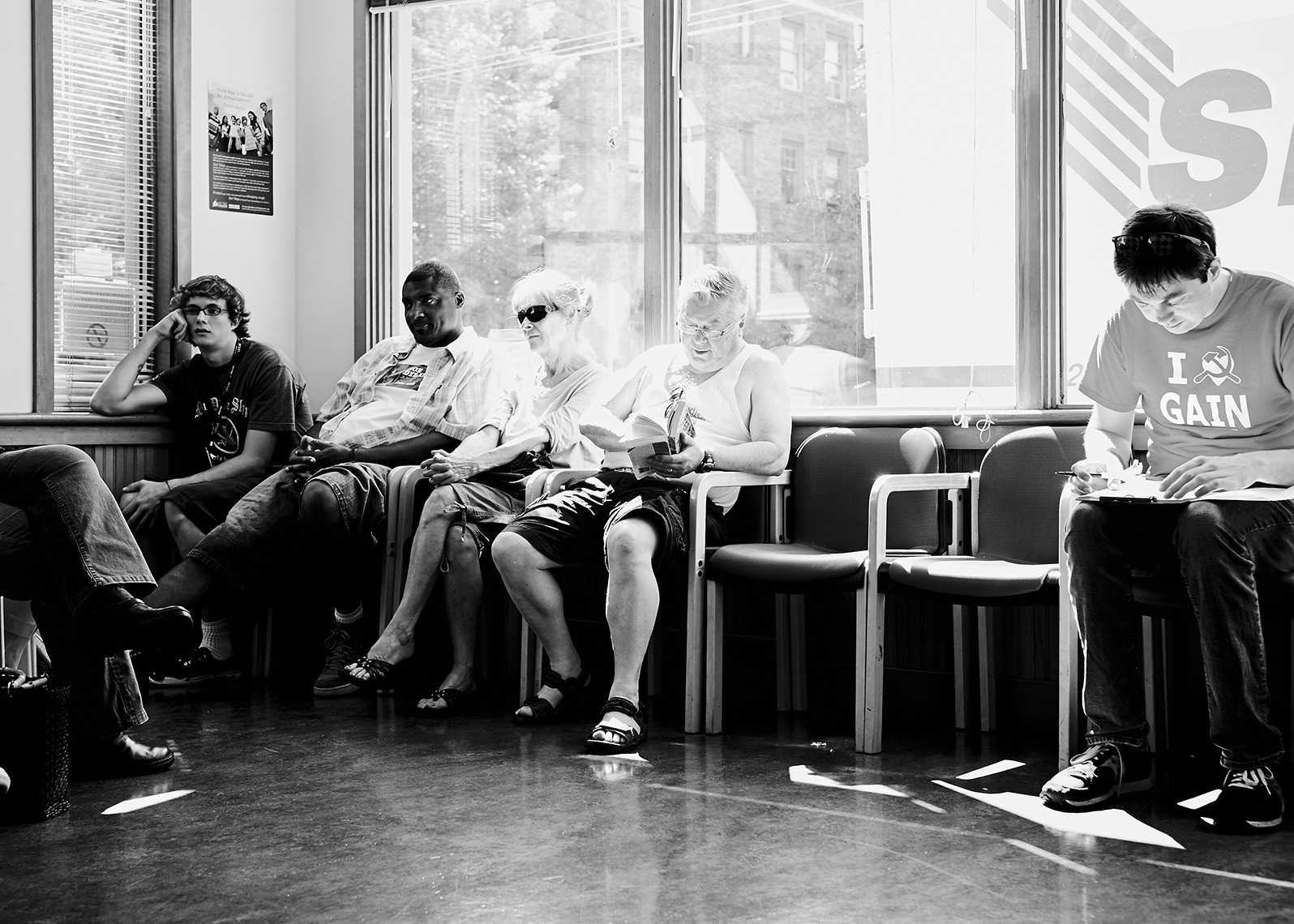 patients in a waiting room at community health facility