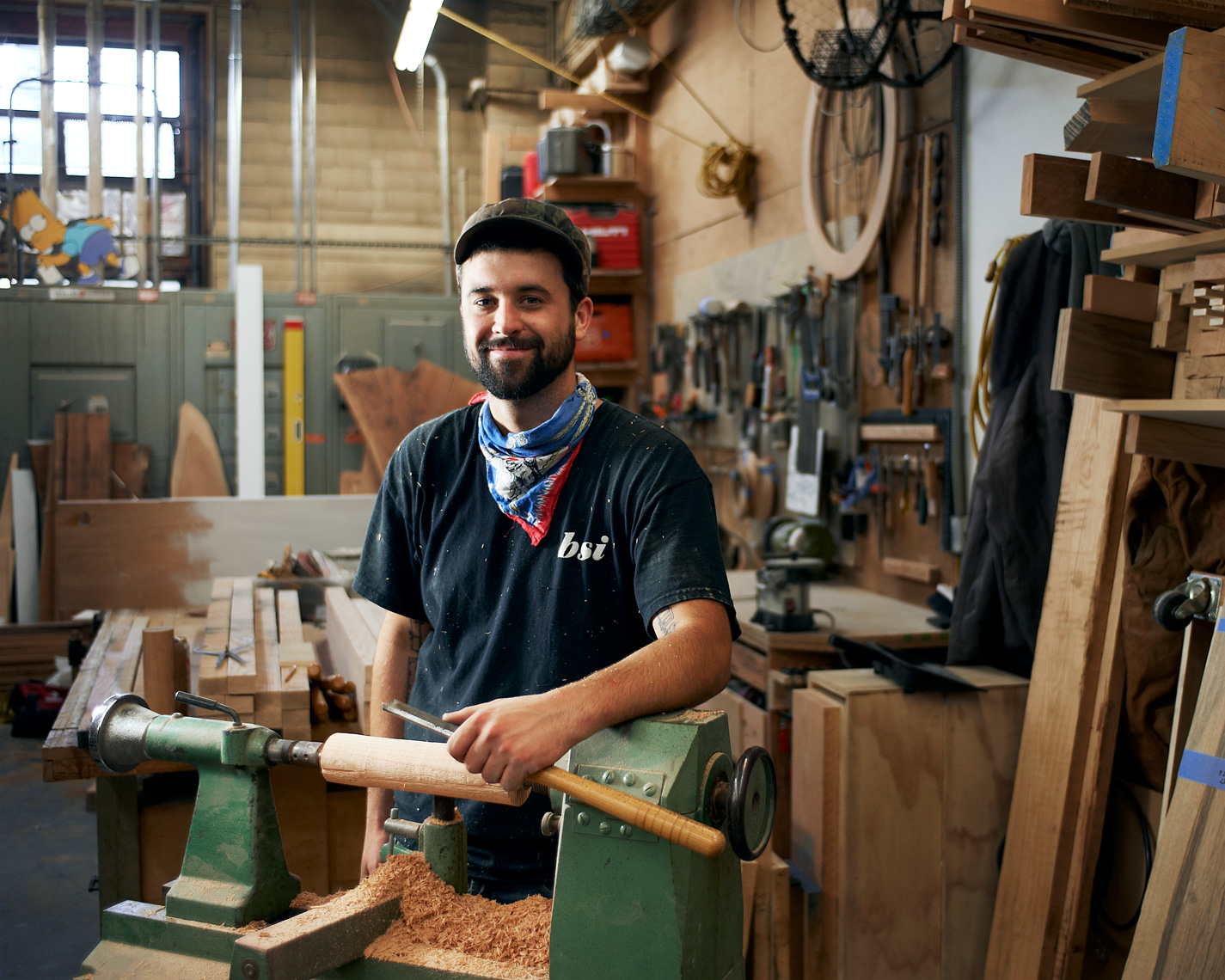 Woodworker poses among his tools for this workplace portrait