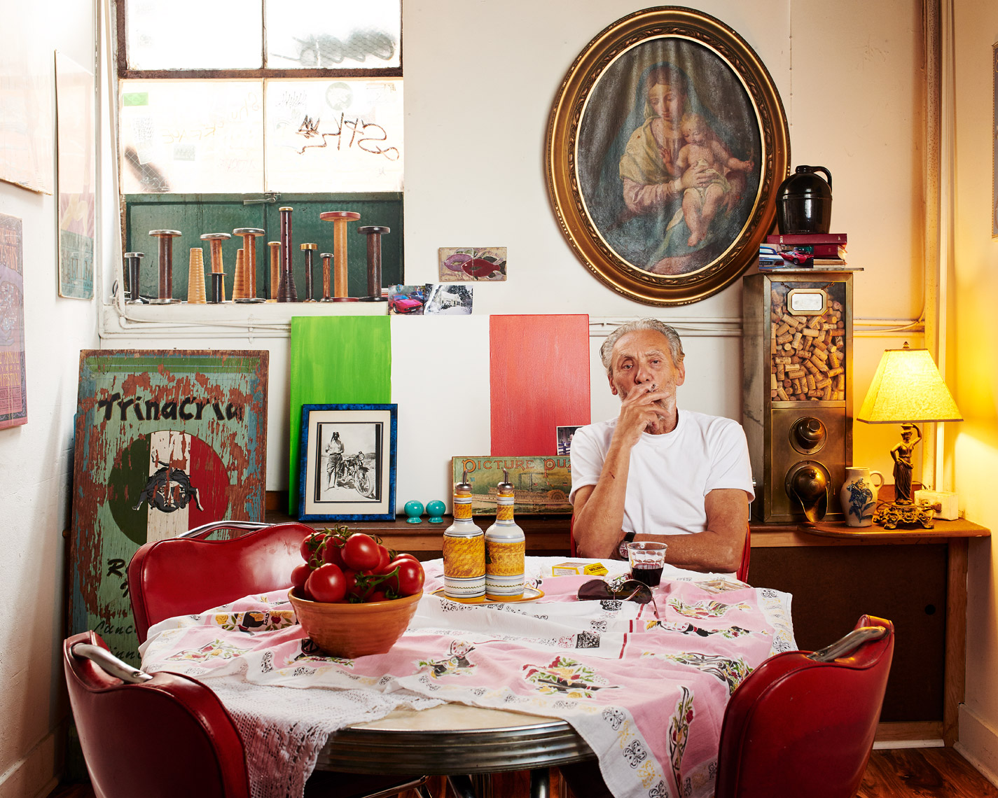 A chef  sits in his office for this candid portrait