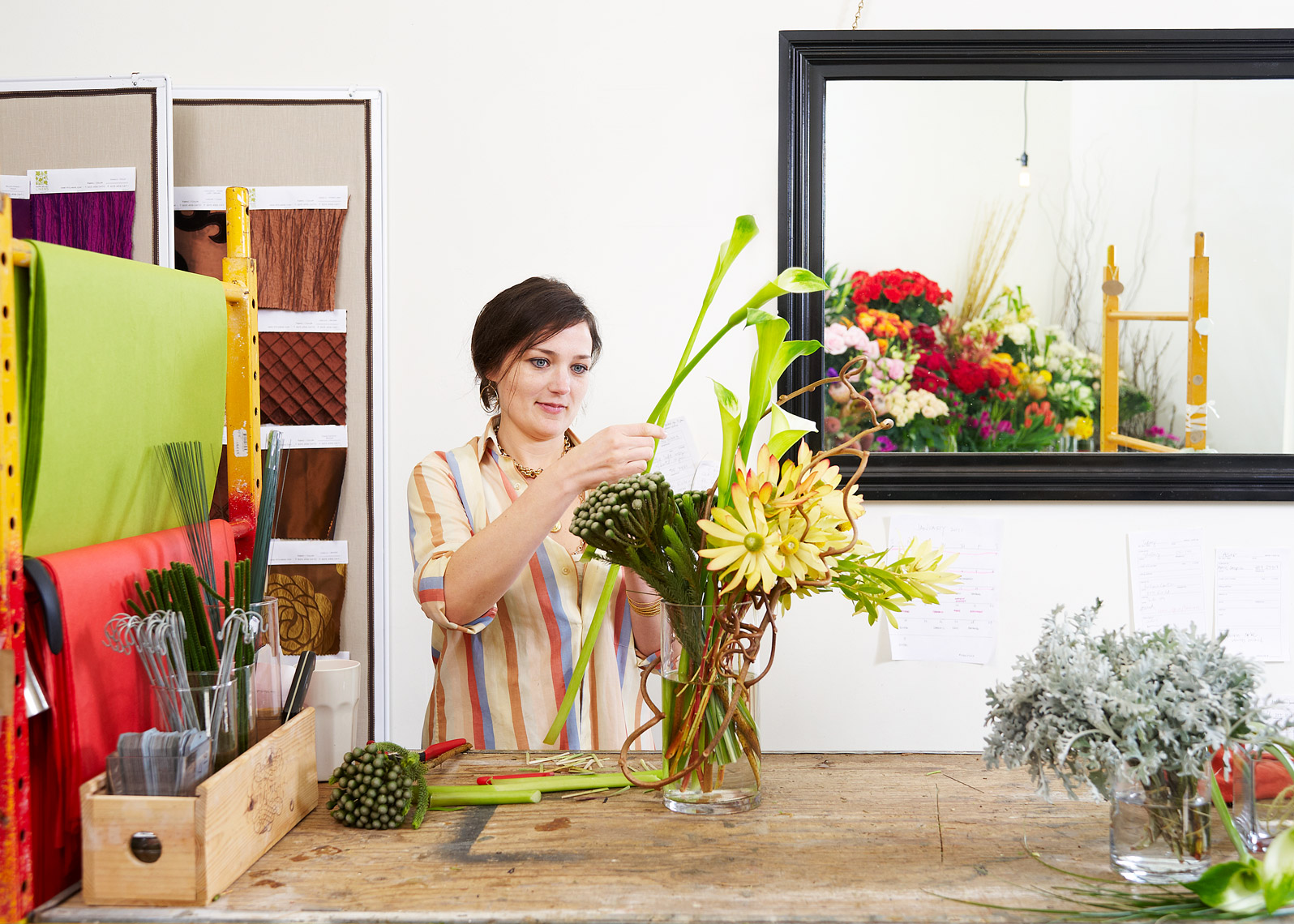 Woman arranges flowers for a brand shoot
