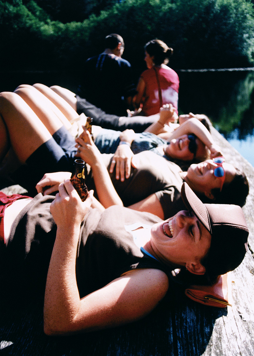Relaxing girls on dock