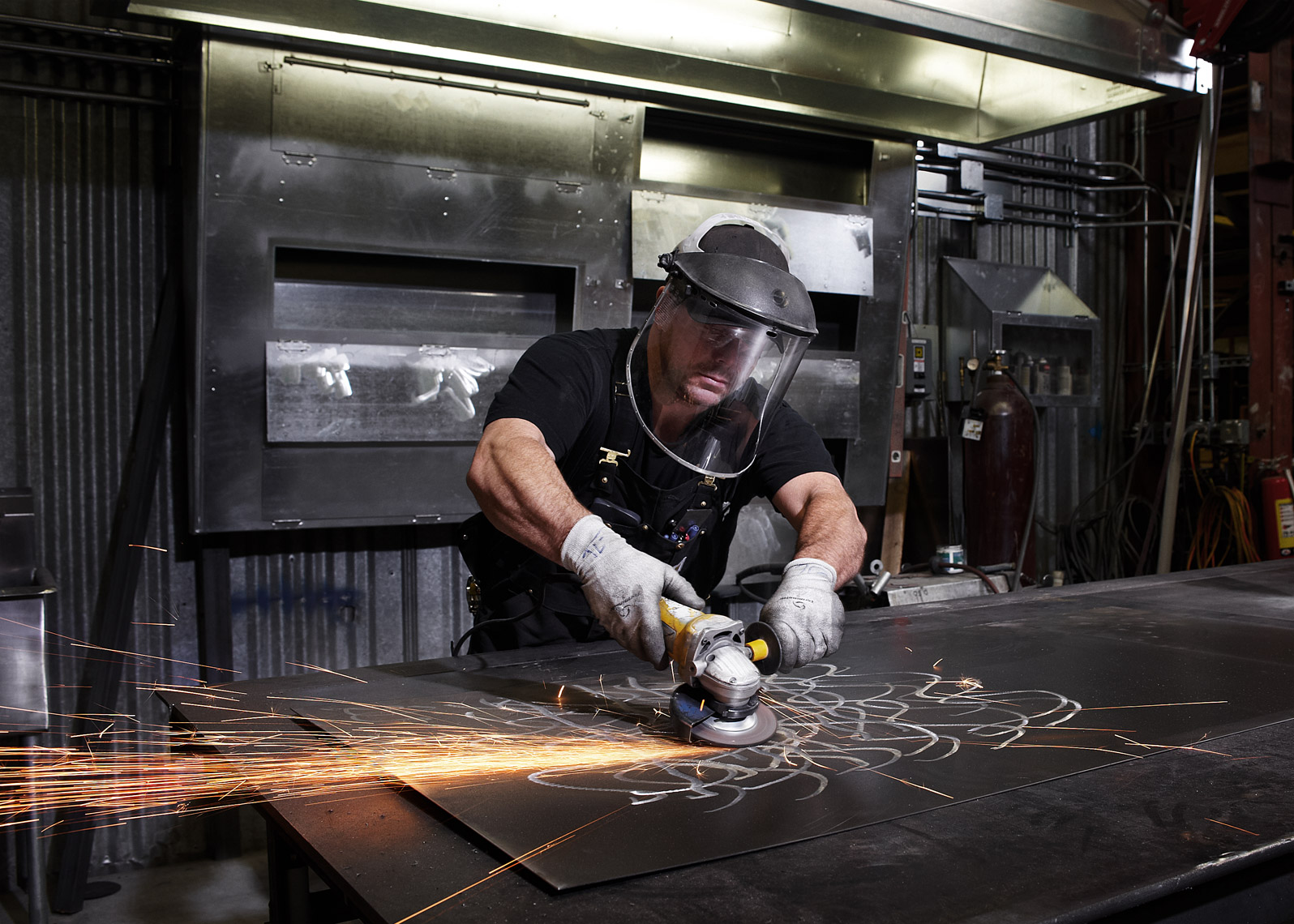 sheet metal worker photographed in action