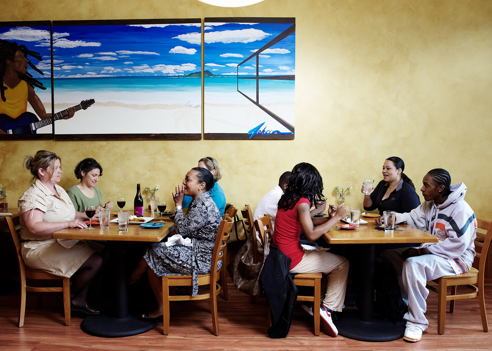Diner enjoy a meal at Island Soul as captured by  Seattle Magazine photographer Amos Morgan