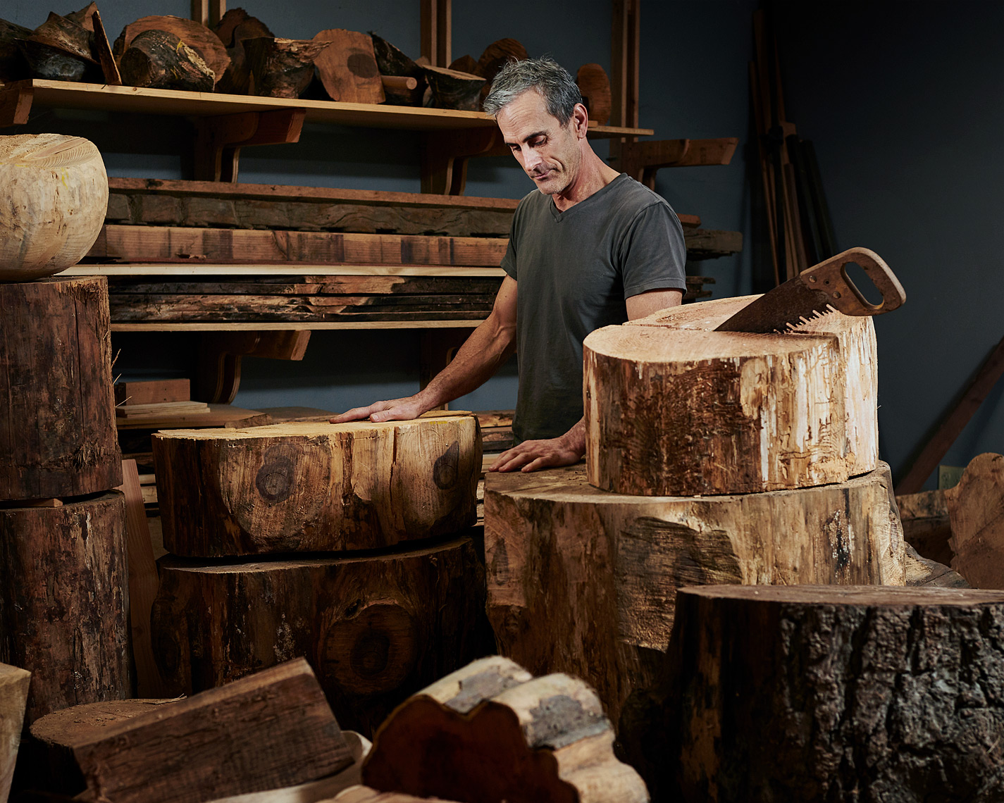 magazine portrait of artist Joel Sayer in his wood studio