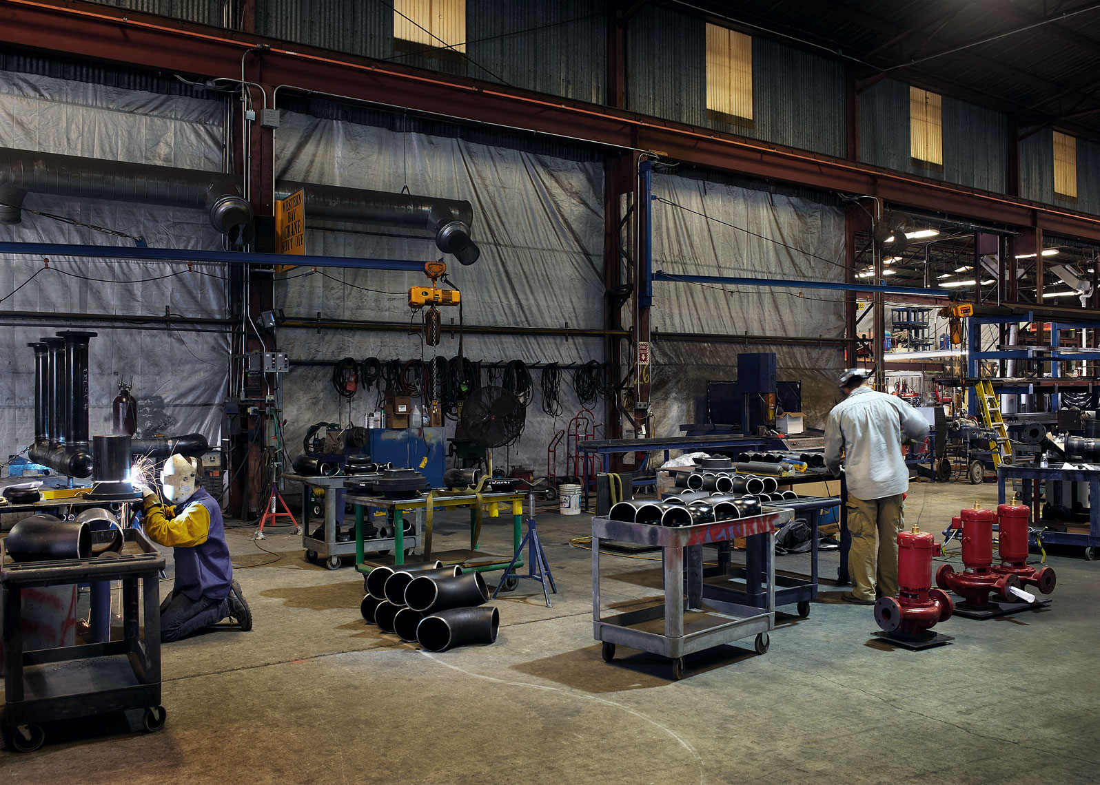 Seattle industrial photographer captures these men working in their shop