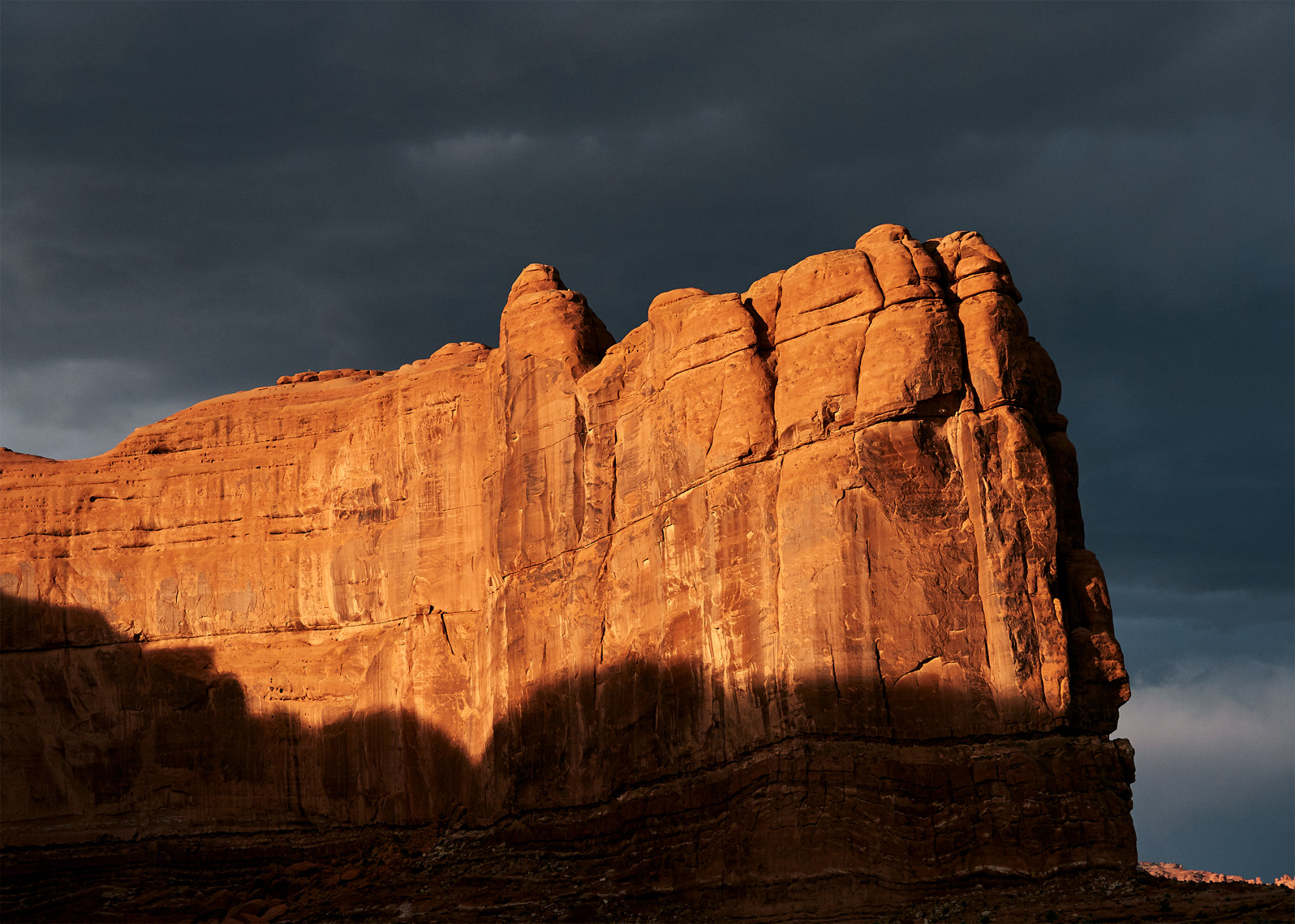 Moab rock formation storm looms dramatic landscape