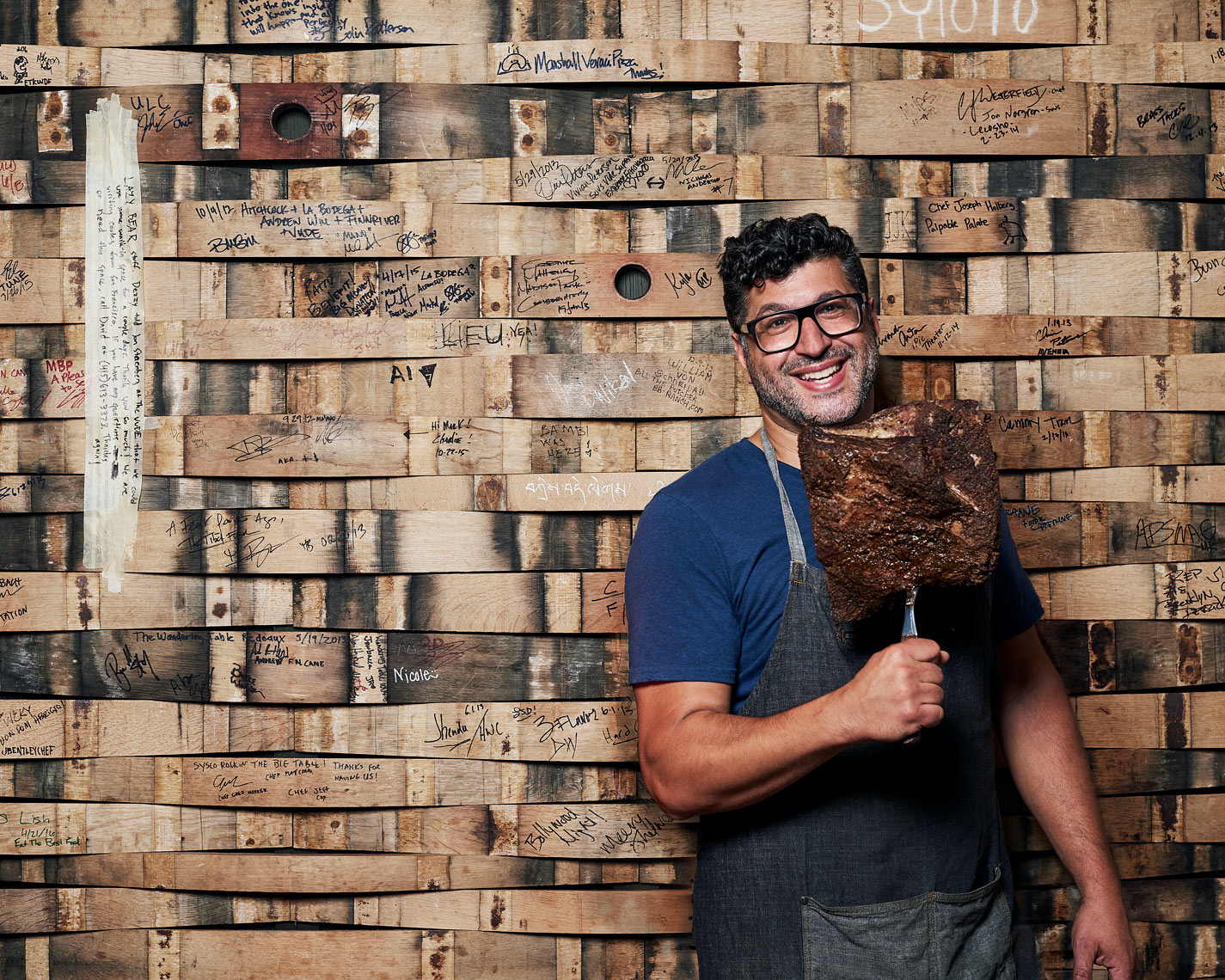 Man poses with pastrami for magazine portrait