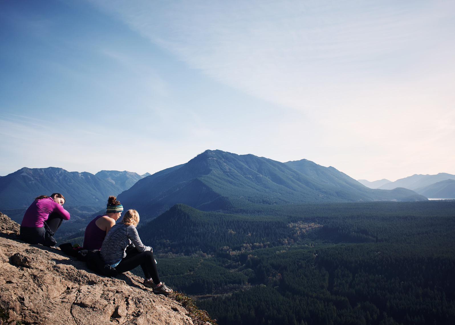 Hikers rest at the peak overlooking rattlesnake lake