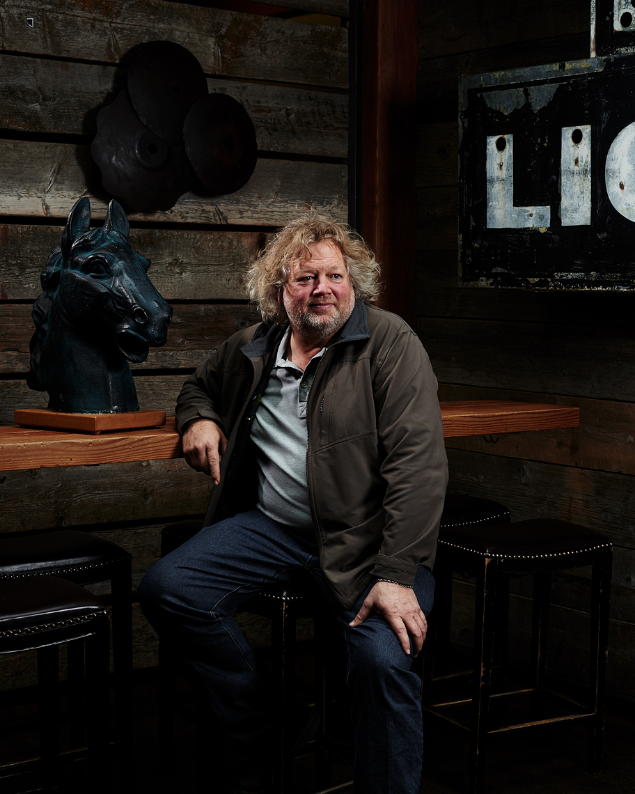 Restauranteur Tom Douglas sits for his portrait in his Seattle restaurant