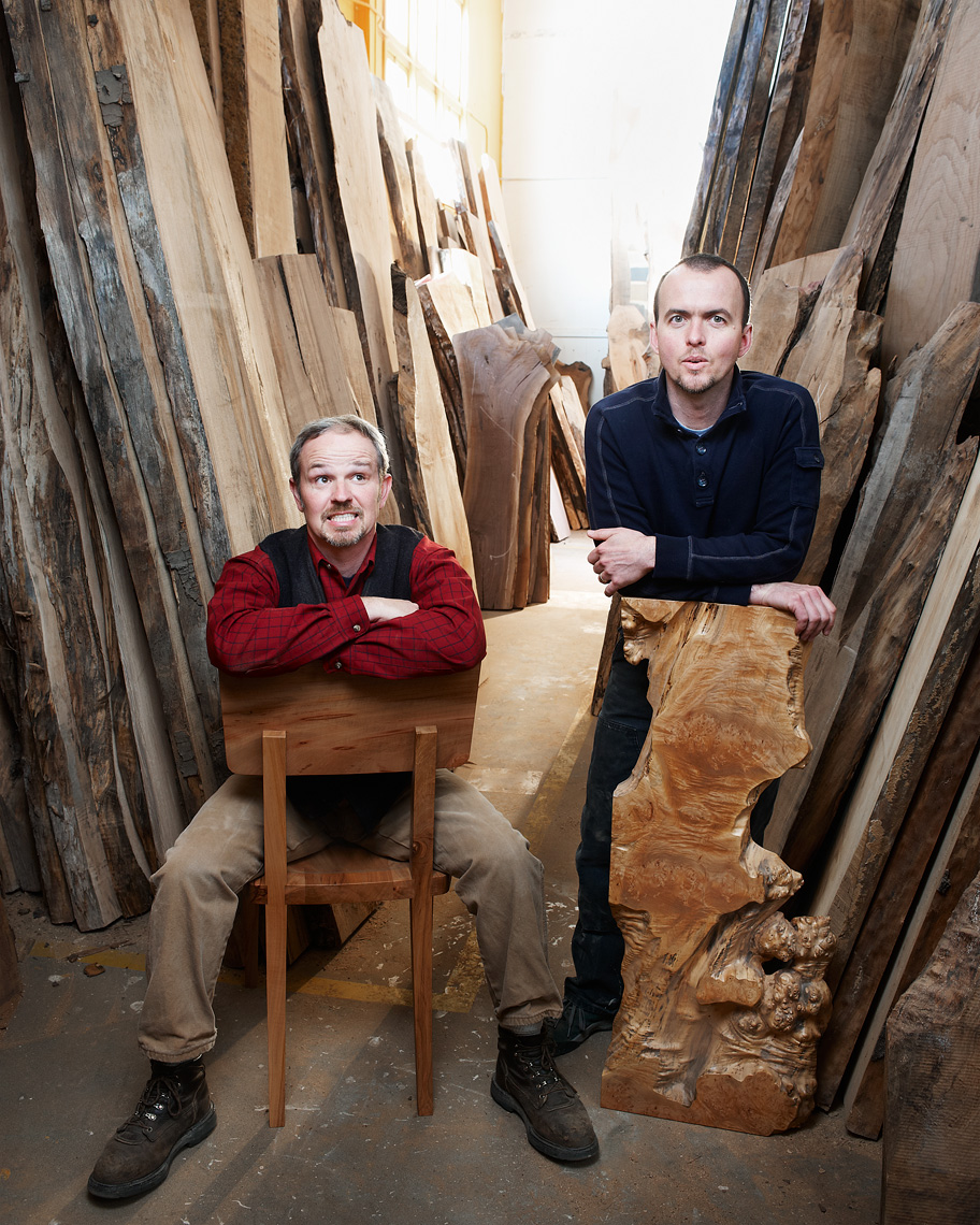 artist woodworkers pose with raw wood for their portrait